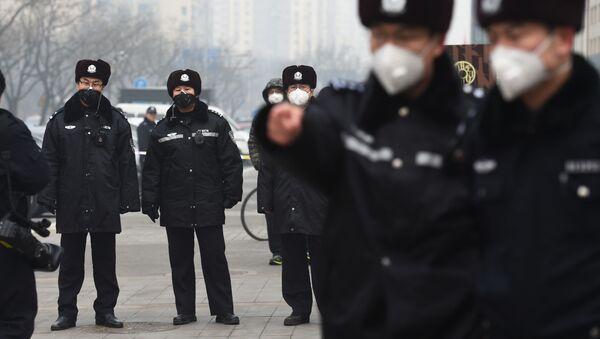 Čínská policie v Pekingu - Sputnik Česká republika