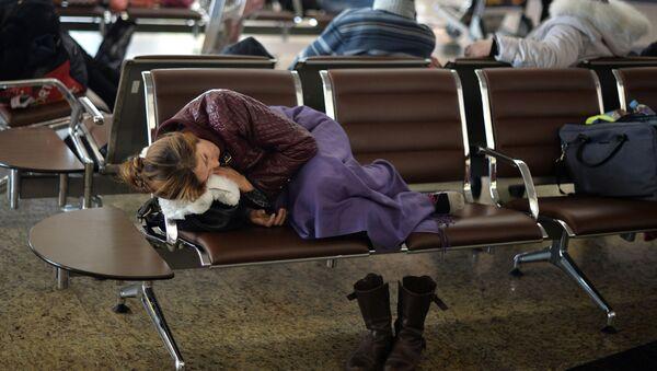Cestující na letišti. Ilustrační foto - Sputnik Česká republika