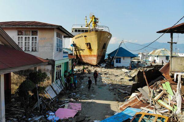 Fotografie z uplynulého týdne: Od módních přehlídek až po následky tsunami - Sputnik Česká republika
