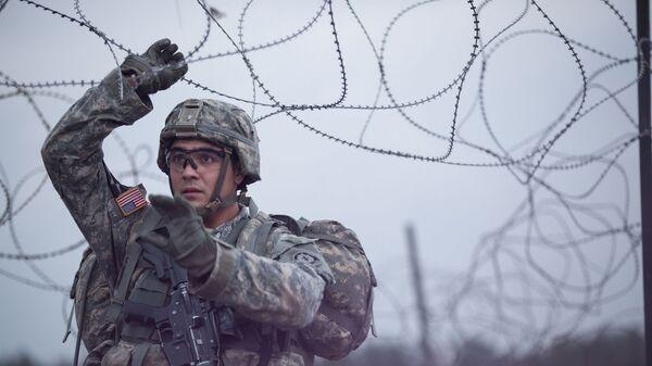 Americký voják během cvičení NATO v Evropě - Sputnik Česká republika