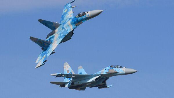 Stíhací letouny Su-27 ukrajinského letectva během cvičení Čisté nebe 2018 - Sputnik Česká republika