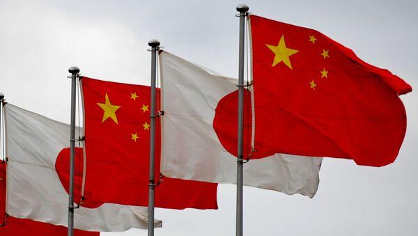 Vlajky Číny a Japonska - Sputnik Česká republika