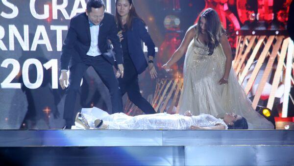 Vítězka soutěže krásy  Miss Grand International omdlela na jevišti po oznámení jejího vítězství - Sputnik Česká republika