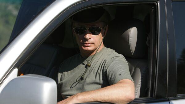 Ruský prezident Vladimir Putin na dovolené v Tyvské republice - Sputnik Česká republika