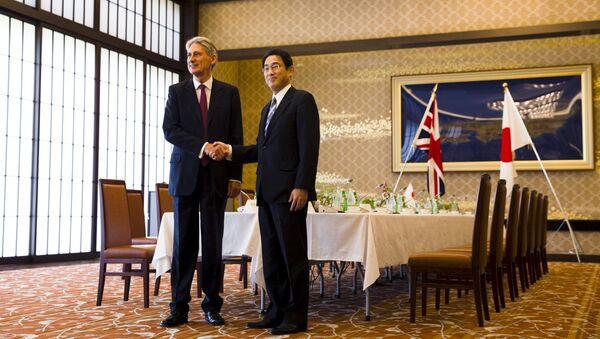 Ministři zahraničí Japonska a Velké Británie během setkání v Tokiu - Sputnik Česká republika