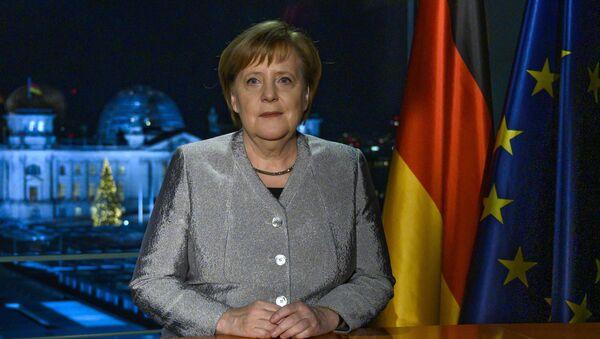 Angela Merkelová během svého novoročního projevu - Sputnik Česká republika
