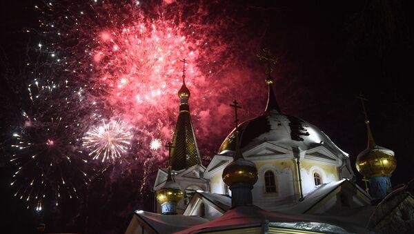 Slavnostní mše a ohňostroj. Jak se slaví Vánoce v Rusku - Sputnik Česká republika