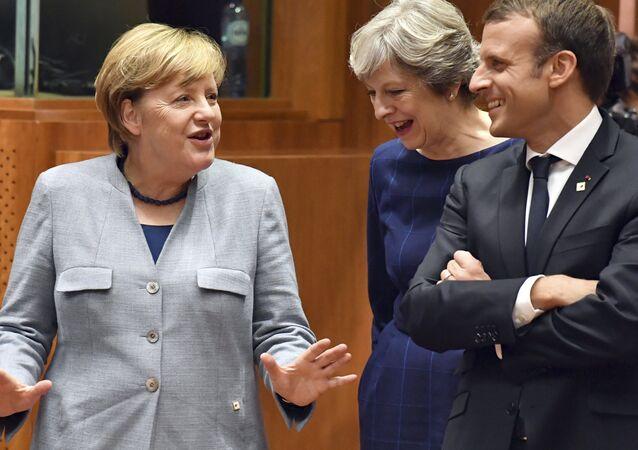 Angela Merkelová, Theresa Mayová a Emmanuel Macron