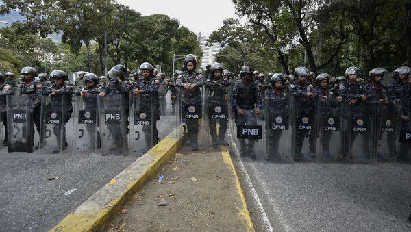 Venezuelská policie při protestu v Caracasu - Sputnik Česká republika