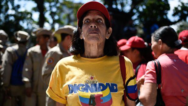 Venezuelka na náměstí v Caracasu - Sputnik Česká republika