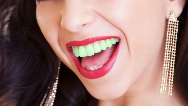 Dívka se zelenými zuby. Ilustrační foto - Sputnik Česká republika