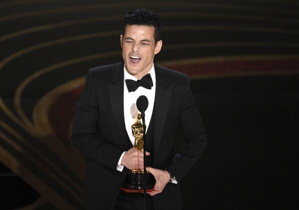 Актер Рами Малек с наградой за лучшую мужскую роль на церемонии вручения Оскар-2019 - Sputnik Česká republika