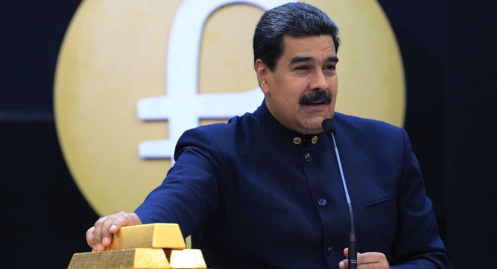 Handout photo released by the Venezuelan Presidency of Venezuelan President Nicolas Maduro speaking next to gold ingots in Caracas on March 22, 2018