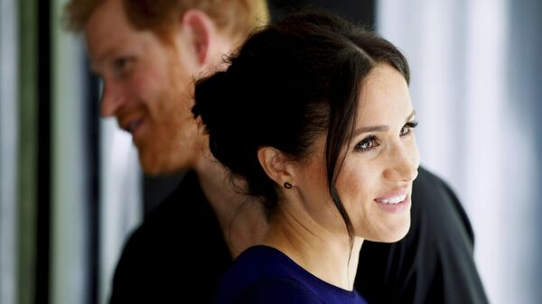 Britain's Prince Harry and Meghan, Duchess of Sussex smile during their visit to the National Kiwi Hatchery at Rainbow Springs in Rotorua, New Zealand, Wednesday, Oct. 31, 2018 - Sputnik Česká republika