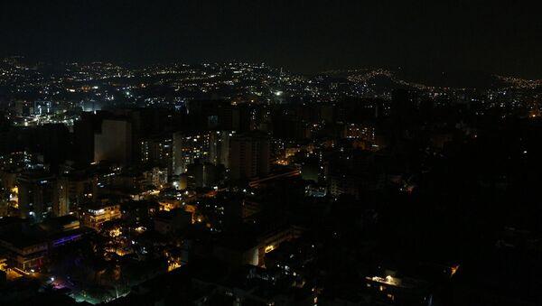 Ulice a domy v Caracasu s částečně obnovenými dodávkami energie.  - Sputnik Česká republika