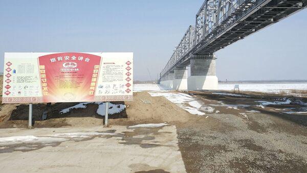 Stavba železničního mostu, který spojí Rusko a Čínu přes řeku Amur - Sputnik Česká republika