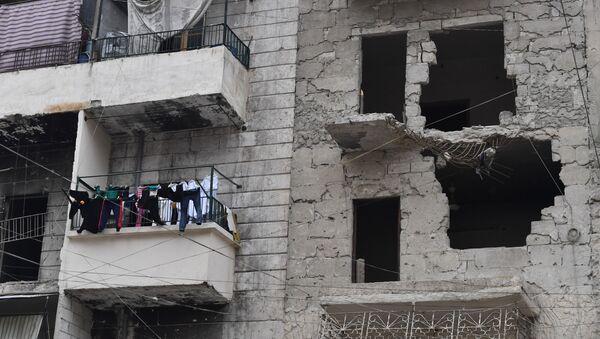 Zničený dům v Aleppu - Sputnik Česká republika