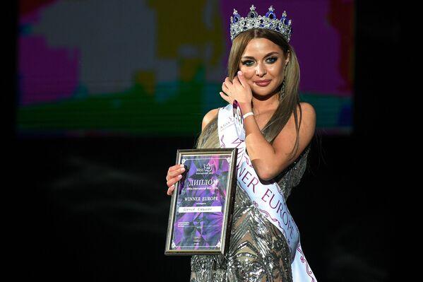 Vítězka soutěže krásy Miss International Mini 2019 Evropa Ksenia Klevtsová na slavnostním předávání ceny  - Sputnik Česká republika