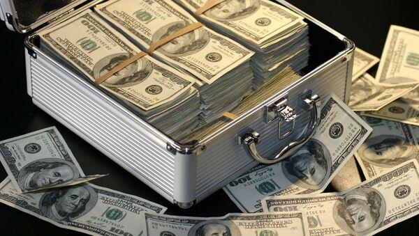 Kufřík s americkými dolary. Ilustrační foto - Sputnik Česká republika