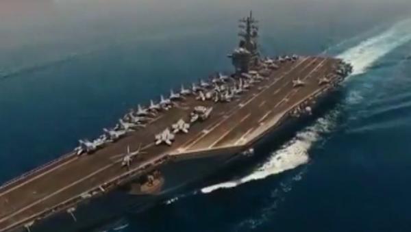 Íránský dron detailně zachytil letadlovou loď USA v Perském zálivu. Na palubě je spousta stíhacích letounů (VIDEO)  - Sputnik Česká republika