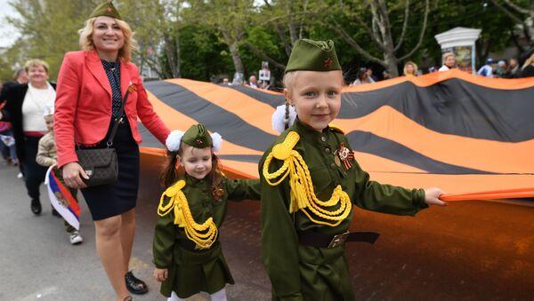 Den, kdy se stírají všechny hranice. Světem prošel kolosální Nesmrtelný pluk - Sputnik Česká republika