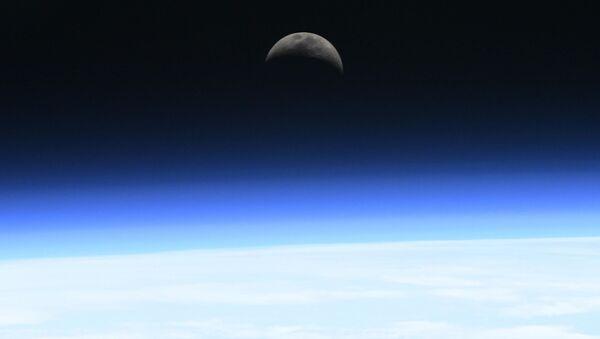 Východ měsíce nad atmosférou - Sputnik Česká republika