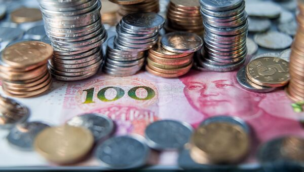 Čínské bankovky a mince - Sputnik Česká republika
